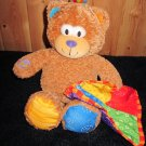 Lamaze giggling Teddy Bear plays Peek a boo