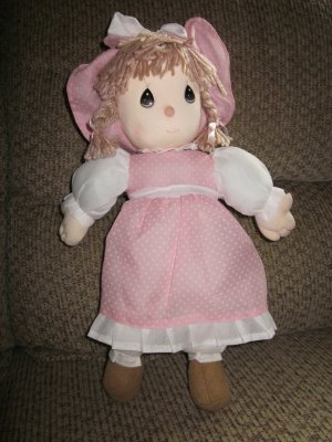 Precious Moments Plush Doll wearing a long dress and pantaloons