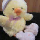 Hallmark Fluffy Yellow Chenille Chick wearing bunny slippers