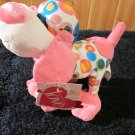 Joyful Plush Dog distributed by Walmart.  Pink Blue Green Yellow polka dots