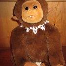 Hosung Paw Palz Plush Monkey holding a baby bottle