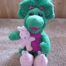 Baby Bop holding pink rabbit Green dinosaur from Barney