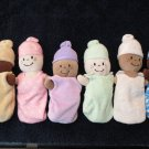 Six Plush Dolls in a Carrier