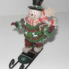 Snowman Wearing Top Hat Ornament on Sled     M2a