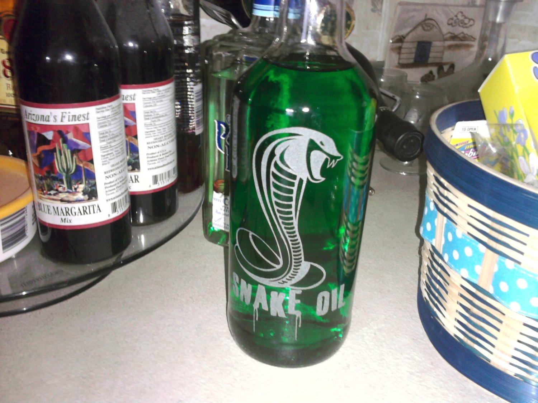 Snake Oil Clear Bottle