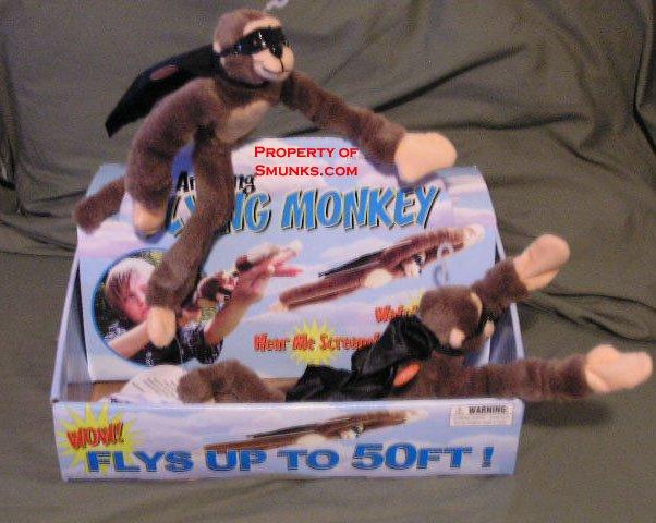 New Screaming Slingshot Flying Monkey Toy WOW $2.99 ea!
