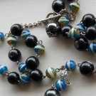 "Funky Tribal Lariat Necklace Luminescent Black and Teal Beads 21.5"" Matinee Length Casual Fun Trendy"