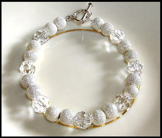 Classy Swarovski Clear Round and Sterling Silver Bracelet