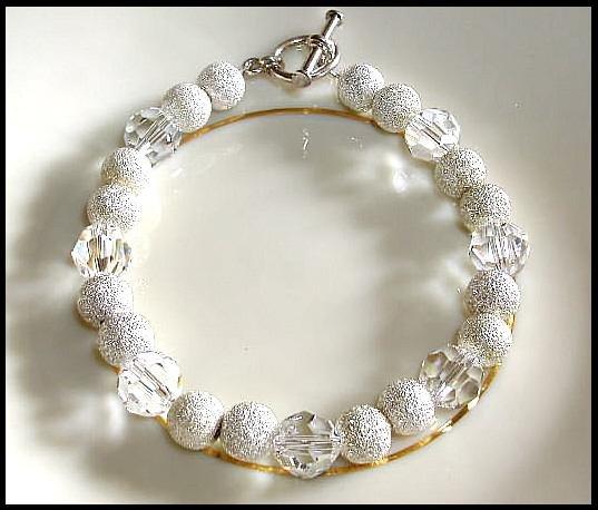 Classy Swarovski Clear Round and Sterling Silver Bracelet