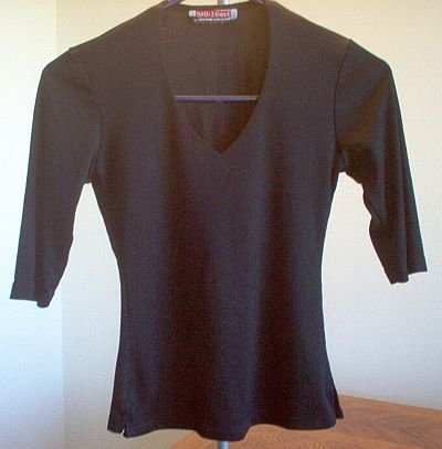 black 34th Street ribbed shirt like new size medium 3/4 sleeve good condition