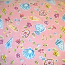 1.75 yard -  Seashells tossed all over coral pink flannel