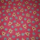 1 yard - Dark red with small sunflowers and checks tossed all over fabric