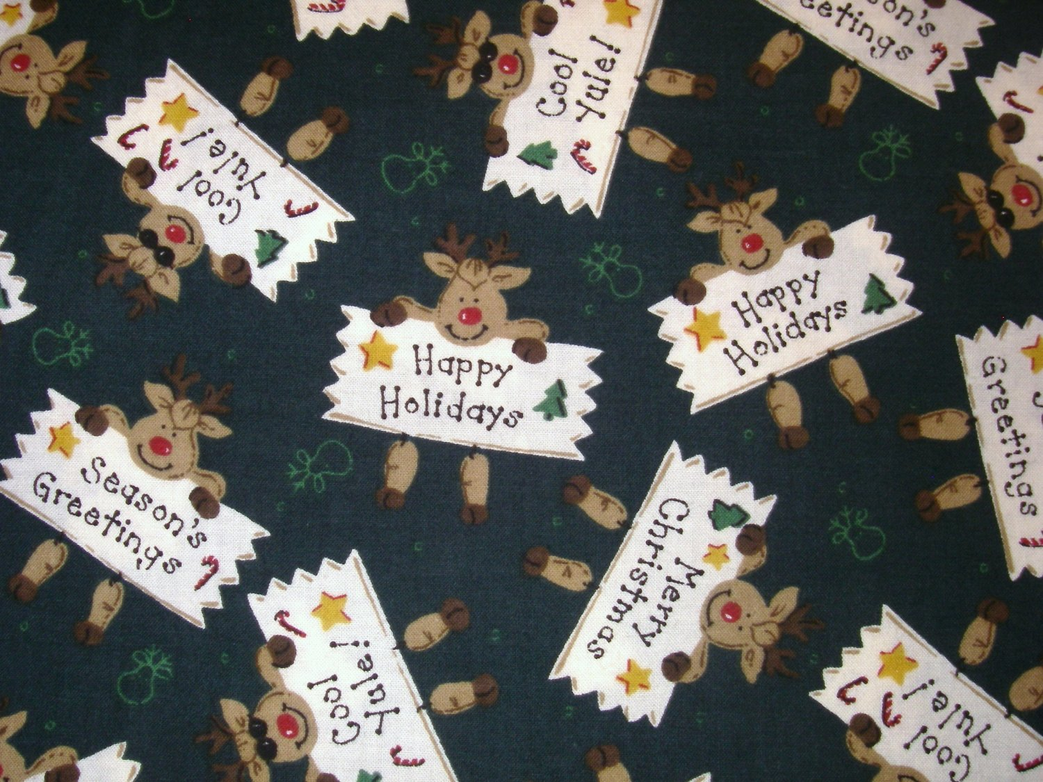 3/4 yard - Dark green fabric with Rudolph reindeer and sayings all over