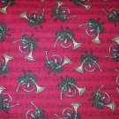 1 yard - Red fabric with French horns and music notes