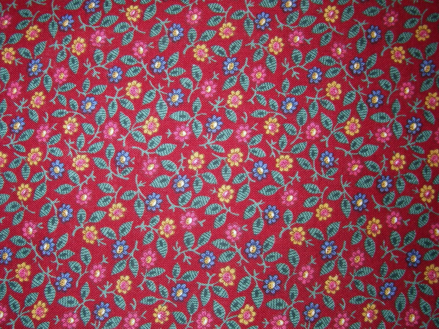 2/3 yard - Dark red fabric with tiny pink, yellow, blue flowers and green leaves all over