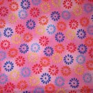 1 yard - Pink fabric with red, blue, yellow and orange designs all over