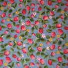 1.75 yard - Pink and red strawberries with green leaves all over medium blue fabric
