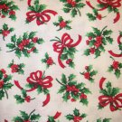 1.875 yards - Off-white fabric with bright green holly and red berries &bows all over fabric