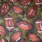 7/8 yard - Green and brown flannel with footballs all over fabric