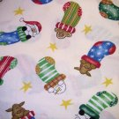 7/8 yard - Off white fabric with holiday characters in stockings with stars tossed all over