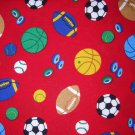1 yard - Sports items all over red fabric