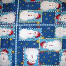 1 yard - Snowmen in squares on blue fabric with stars and checks
