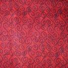 1 yard - Red fabric with S swirls