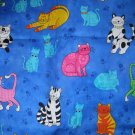 1 yard - Bright cats on blue fabric