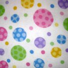 1 yard - Multi-colored dots on white flannel fabric