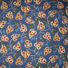 1.9 yards - Folk art leaves on medium blue fabric
