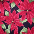 1 yard - Dark red poinsettias on black fabric