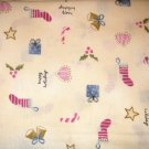 2.66 yard total - Cream colored background with small holiday items all over fabric