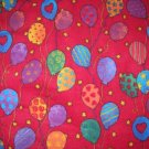 2.33 yards - Bright colorful balloons all over red flannel fabric
