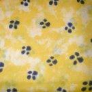 1 yard - Dog paws on yellow marble fabric - Black, yellow, light yellow