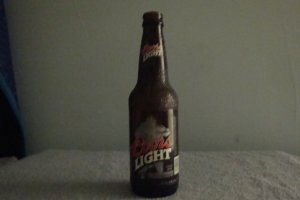 COORS LIGHT PIGSKIN BOTTLE 1999 LIMITED EDITION