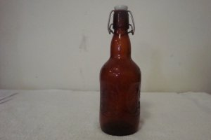 GROLSCH LARGER AMBER BEER BOTTLE W/PORCELAN STOPPER