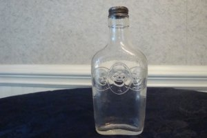VINTAGE WILKEN FAMILY DISTILLERY BOTTLE W/ORIGINAL CAP
