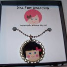 Doll Face Pendant, Brunette with Hot Pink Bow