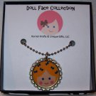 Doll Face Pendant, Blonde with Blue Bows