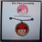 Doll Face Pendant, Red Head with Brown Bow