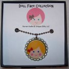 Doll Face Pendant, Blonde with Red Bow