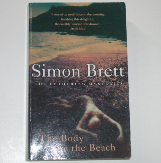 The Body on the Beach by SIMON BRETT Import A Fethering / Carole Seddon Cozy Mystery 2001
