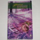 Her Christmas Protector by TERRI REED Love Inspired Christian Romantic Suspense 2007