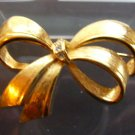 Avon bow pin brooch rhinestone goldtone