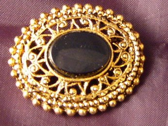 Oval Black Goldtone ornate Pin Vintage
