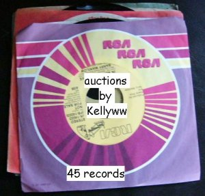 A'ME Lorain Whole Wide World 45 record  Stop twisting my arm