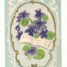 BEST WISHES VIOLETS OPEN BOOK GOLD VINTAGE POSTCARD    #500