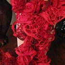 Ruffle scarf in shades of red
