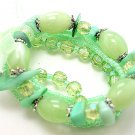 LIGHT OLIVE GREEN MULTI STRAND LUCITE BEAD BALL BRACELET