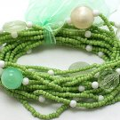 LIGHT OLIVE GREEN MULTI STRAND LUCITE BEAD BALL RIBBON BRACELET